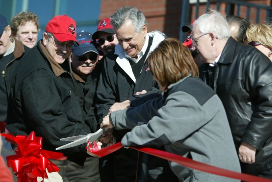 Stavropoulos officially opens Dow Diamond by cutting the ribbon with other organization funders. The Loons played their first home game at the Dow Diamond Friday, April 13, 2007.